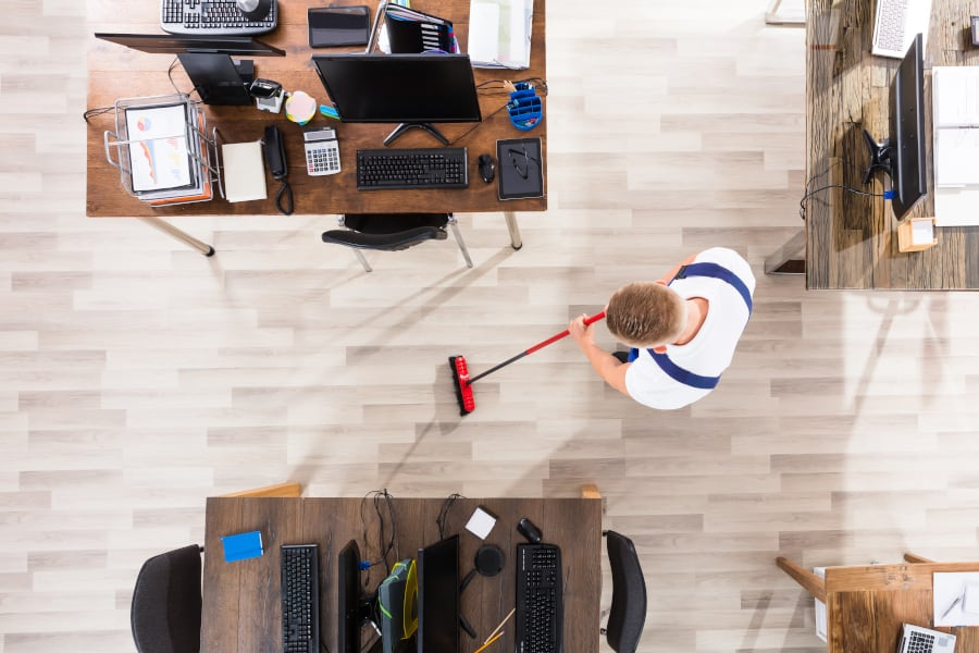 janitor sweeping office floor