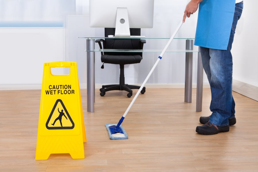 janitor mopping office floor